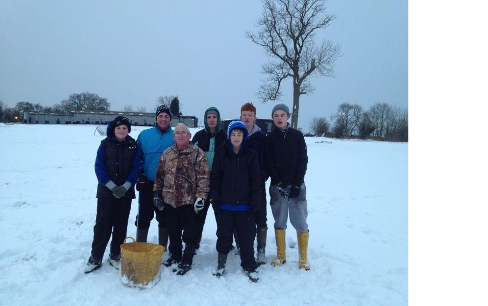collecting golf balls in the snow